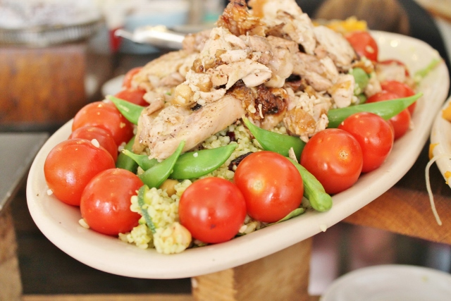 Taylor St Baristas Mayfair chicken and giant couscous salad with giant terry tomatoes, sugar snap peas and sultanas