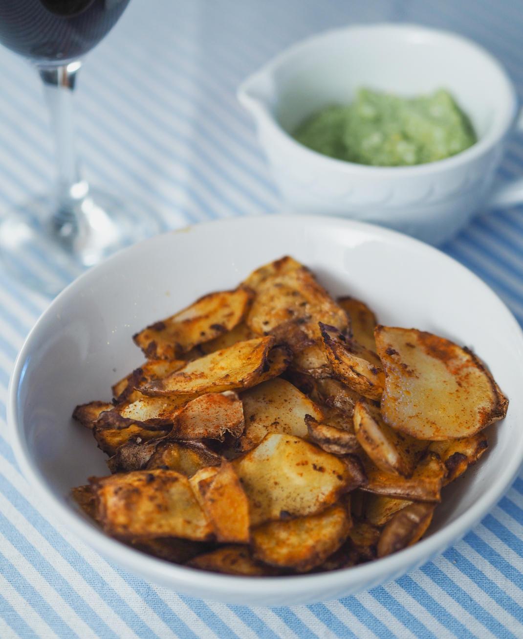 spicy potato peelings and creamy avocado dip