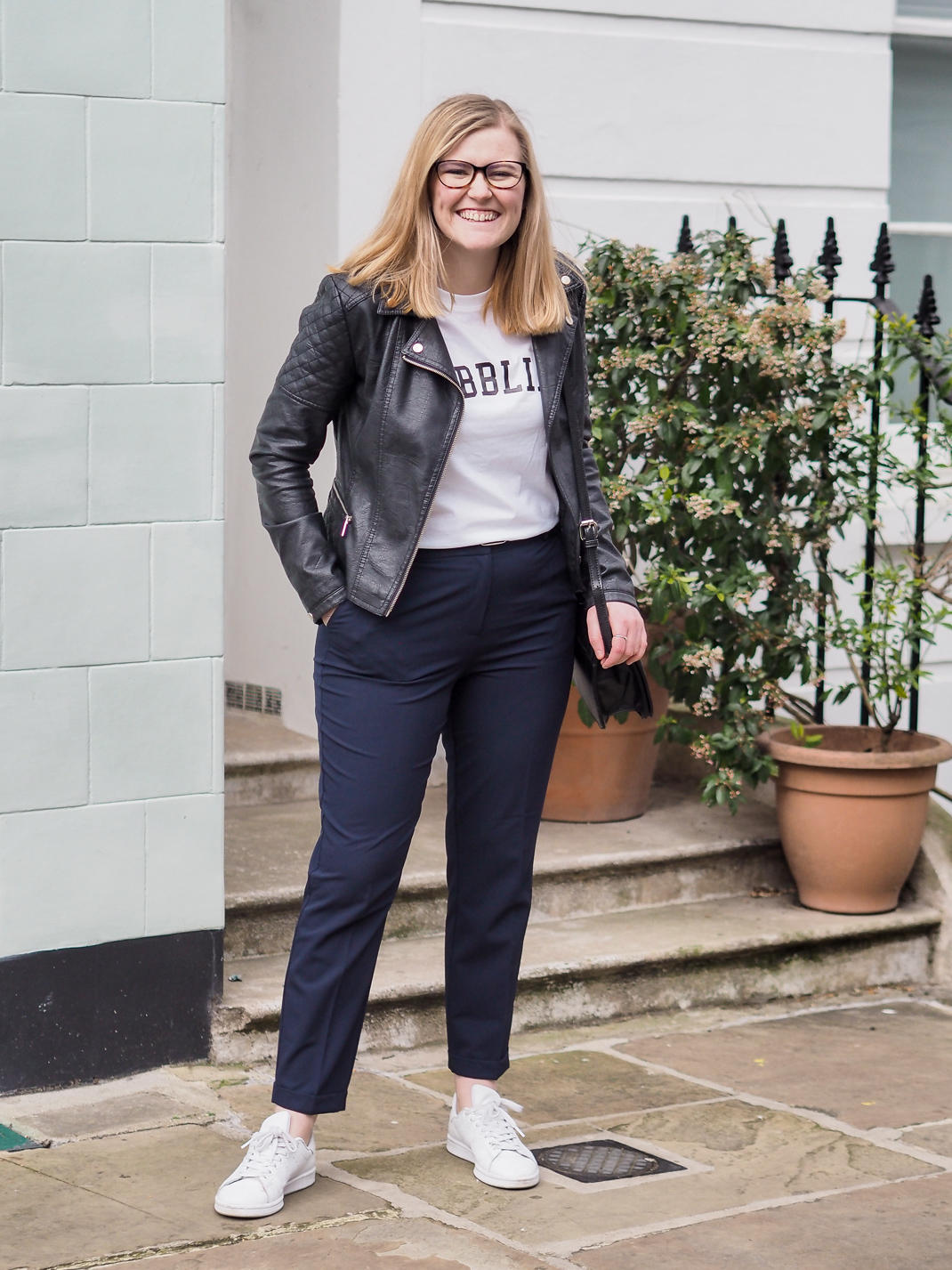 casual outfit: trousers, trainers, tshirt and leather jacket